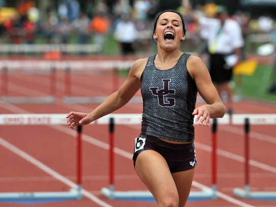 Karlie Zumbro crosses the finish line in the 300-meter hurdles during the 2016 Division II state finals at Jesse Owens Memorial Stadium in Columbus.