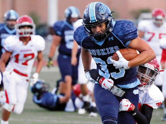 Rudy Gutierrez—El Paso Times Chapin's Brannon Bullitt, 33, gains yardage before he was brought down by a Jefferson defender Thursday night at Irvin High School.