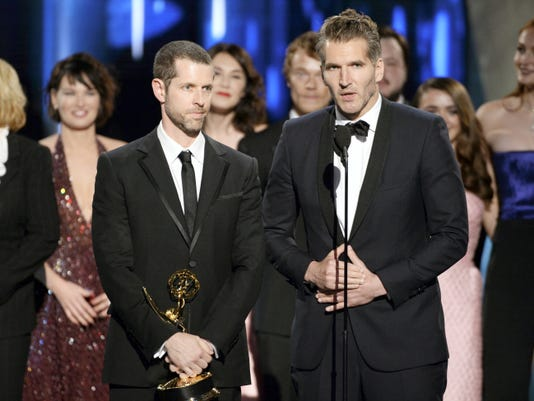 """D.B. Weiss, left, and David Benioff accept the award for outstanding drama series for """"Game of Thrones."""""""