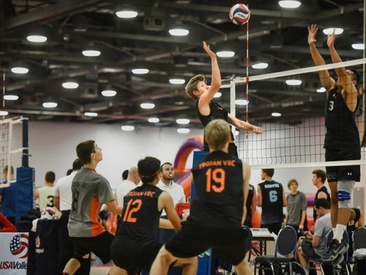 York Suburban's Jarod Pichler (15) attempts a shot as Gavin Dean (8), Josh Upadhyay (12) and Zach Weinstein (19) line up behind him during an 18 Club division match against California team OCVC on July 1 at the USA Volleyball Boys' Junior National Championships in Columbus, Ohio.