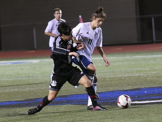 Cumberland Valley's Angel Esquivias, left, collides with John Ramirez, of Chambersburg, on Thursday.  The Eagles won, 2-1.