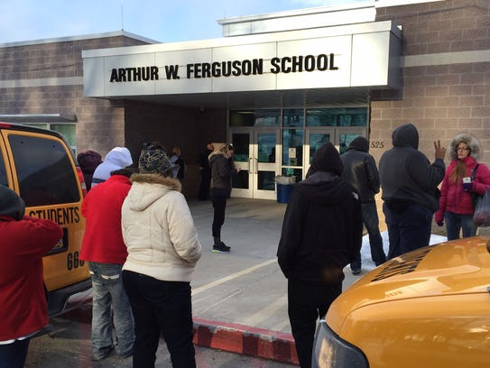 Parents wait for their children at Ferguson K-8 after