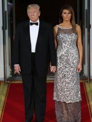 President Trump and first lady Melania Trump waitto