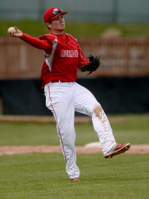 Richmond's Isaak Snyder throws to first after fielding a ball hit short in the infield by Franklin County during a baseball game Saturday, April 2, 2016 on John Cate Field at McBride Stadium.