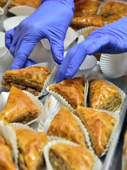 Baklava is prepared Wednesday for the 2016 Greek Fest at Holy Trinity - St. John the Theologian Greek Orthodox Church in Jackson this weekend.