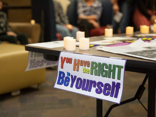 Students from area high schools and Dixie State University meet in the Gardner Center to hold a vigil in memory LGBTQIA people who have been victims of violent crimes Monday, Nov. 21, 2016.