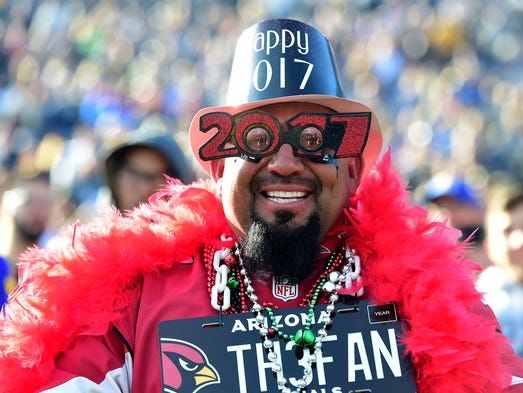 An Arizona Cardinals fan smiles before the game against