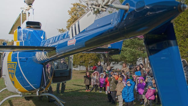 Vineland's Tiny Tots preschoolers take a close look at a NJ State Police helicopter during a visit, Tuesday, Nov. 14, 2017. The state troopers landed the helicopter in an open field across the street from the East Elmer Road school.