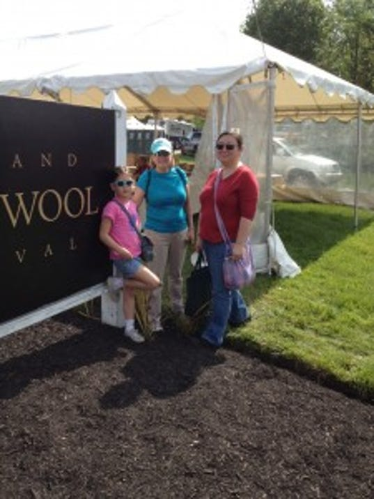 Here we are at the entrance: Lila, Karen and Jung, about to spend a day among the fibers, and sheep of the Maryland Sheep & Wool Festival.