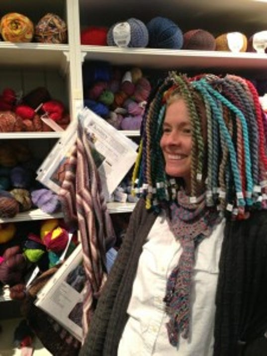 My friend Linda turned a bunch of embroidery threads into a wig at Knit-Knack, the yarn store in Maplewood, during the 2013 Yarn Crawl.