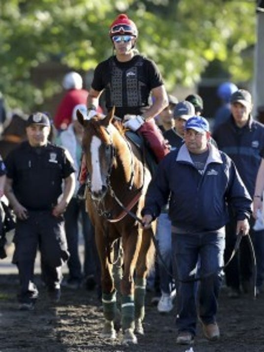Alan Sherman, shown leading California Chrome onto the track before morning training Friday, tells us what the Kentucky Derby and Preakness winner would be like if he were human. Photo by Michael Clevenger