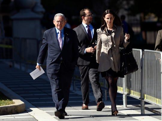 U.S. Sen. Bob Menendez, left, leaves court in Newark