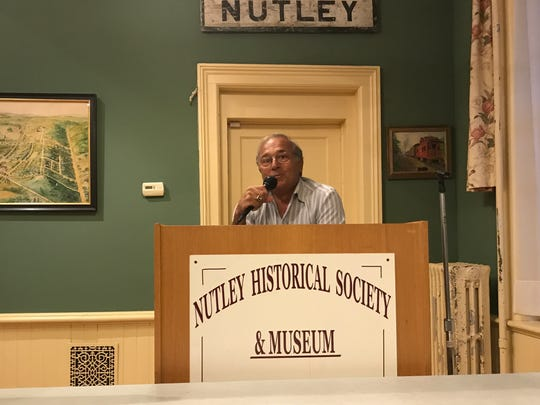 Former Nutley High School coach Carmen LoRe addresses the Nutley Museum's wrestling program.