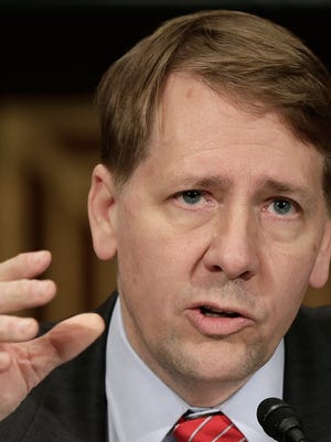 Richard Cordray, director of the Consumer Financial Protection Bureau, testifies at a congressional hearing in Washington, D.C., in 2013.