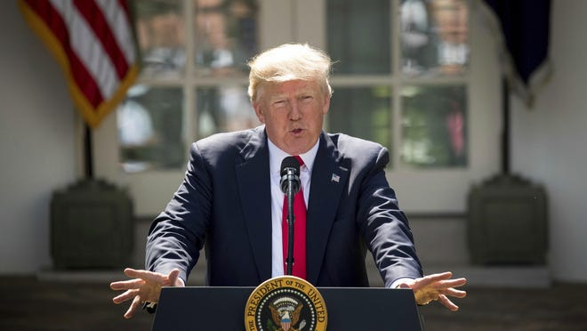 Andrew Harnik/APPresident Donald Trump speaks about his decision to withdraw the U.S. from the Paris climate accord Thursday in the Rose Garden at the White House. President Donald Trump speaks about the U.S. role in the Paris climate change accord, Thursday, June 1, 2017, in the Rose Garden of the White House in Washington. (AP Photo/Andrew Harnik)