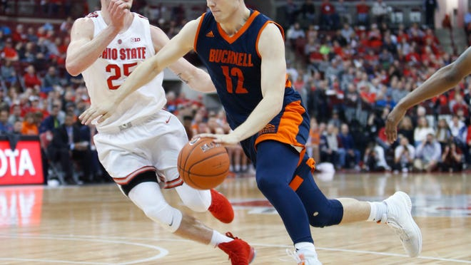 Bucknell's John Meeks, right, dribbles past Ohio State's Kyle Young during the first half of an NCAA college basketball game Saturday, Dec. 15, 2018, in Columbus, Ohio. (AP Photo/Jay LaPrete)