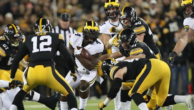 Nov 12, 2016; Iowa City, IA, USA; Michigan Wolverines running back De'Veon Smith is smothered by the Iowa Hawkeyes defense at Kinnick Stadium.