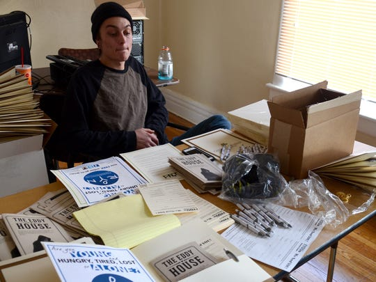Chris Young, 20, helps prepare folders with flyers on Jan. 12, 2015 on The Eddy House Youth Resource Center, set to open in early March, and on a documentary showing at the University of Nevada, Reno on homeless teens on Tuesday.