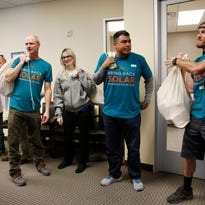 People with the Bring Back Solar campaign prepare to deliver sacks of signed cards in support of decreased solar fees during a meeting of the Public Utilities Commission of Nevada, Friday, Feb. 12, 2016, in Las Vegas.