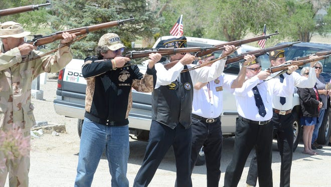 The joint American Legion and VFW color guard fires off the traditional 21-gun salute at Monday's Memorial Day ceremony at Valley View Cemetery.