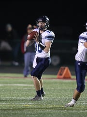 Lewis Central quarterback Max Duggan throws a pass