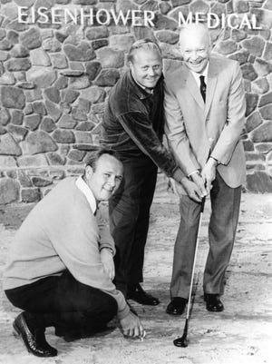 Arnold Palmer, Jack Nicklaus and Dwight Eisenhower stand on the future site of the Eisenhower Medical Center in Rancho Mirage on Jan. 31, 1967.