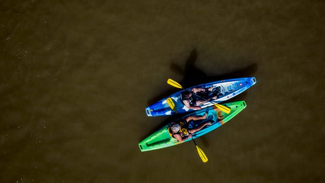More than 2,000 people participate in the Ohio River Paddlefest event Saturday, Aug. 5, 2017. Paddlers navigated a 9-mile course.