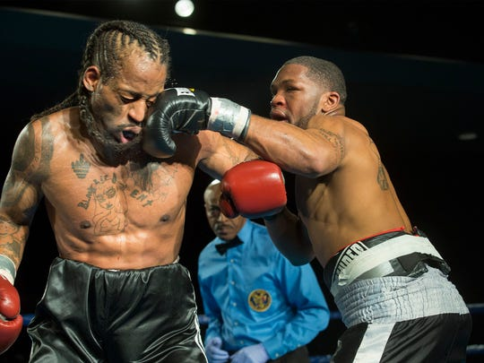 Darryl Bunting gets in left hook on Darryl Watkins during their fight at the Claridge in Atlantic City.