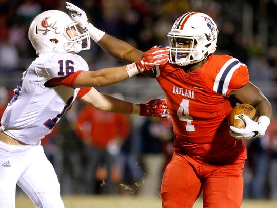Oakland's Mookie Wilson (4) runs the ball as Cookeville's Cooper Norrod (16) moves in for the tackle and is called for a face mask during the third round of play-off games against Cookeville on Friday, Nov. 17, 2017, at Oakland.