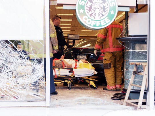 Rescue workers tend to injured driver inside the Barnes and Nobles store at 111 South Central Avenue in Hartsdale Oct. 13, 2006. The car went from the parking lot into the store injuring the driver and one store employee ( Frank Becerra Jr. / The Journal News )