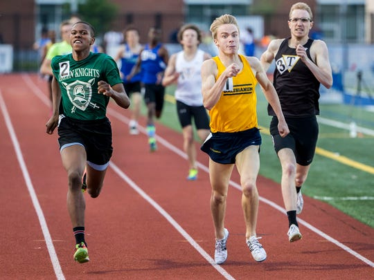 Mt. Pleasant's Johnelle Joe (No. 2) races to the outside of Salesianum's Colin Parker (No. 1) as they race to the finish in the Boys 800 Meter Run event at the Meet of Champions at Dover High School on Wednesday evening. Joe finished first over Parker, winning by .05 seconds.