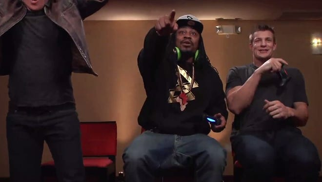 Marshawn Lynch and Rob Gronkowski played video games.