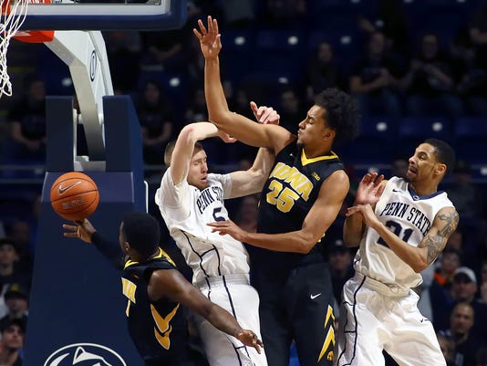 Penn State forward Donovan Jack (5) is fouled going for a rebound by Iowa forward Dom Uhl (25) during the second half of an NCAA college basketball game in State College, Pa., Wednesday, Feb. 17, 2016.  (AP Photo/Chris Knight)