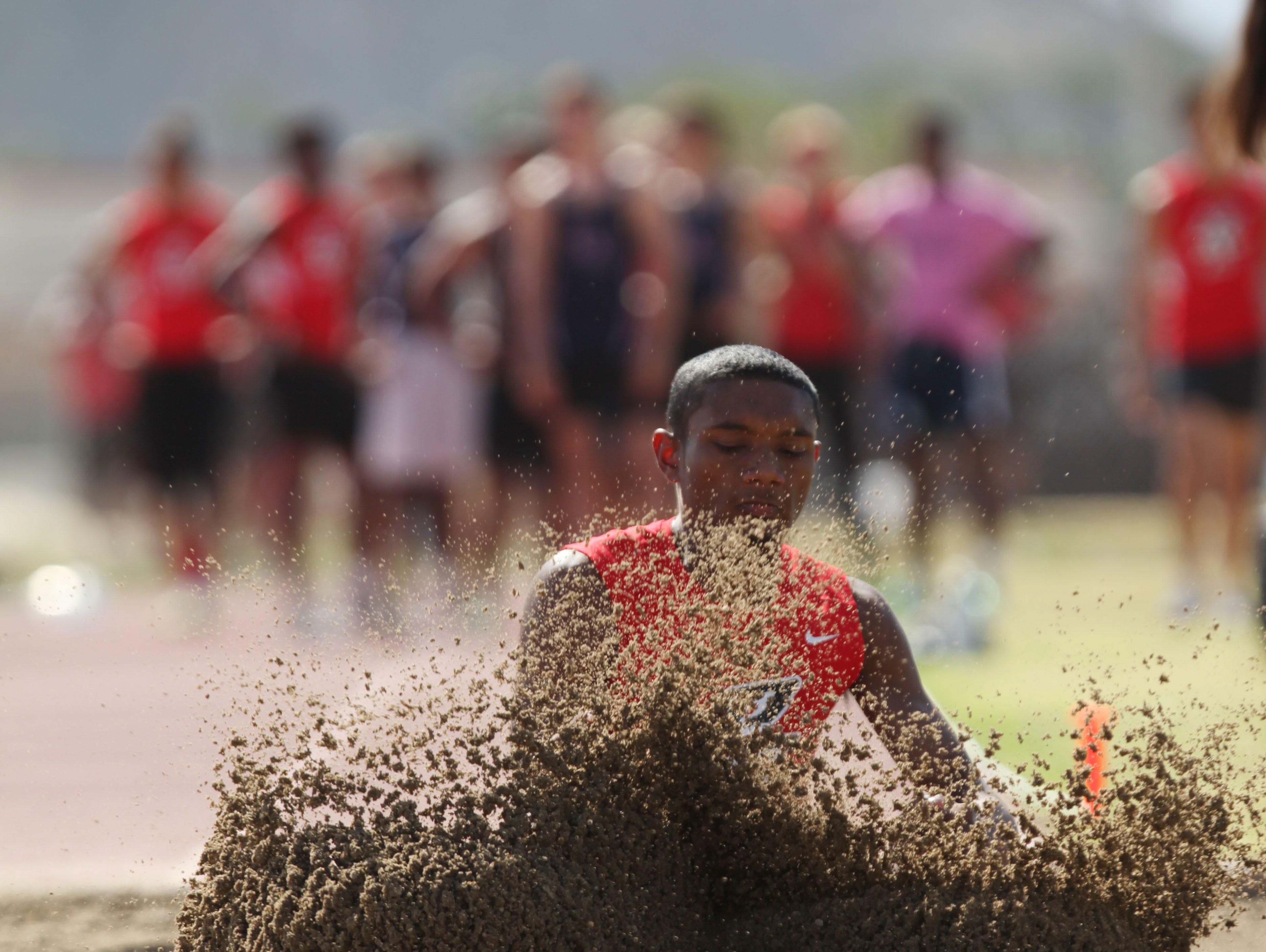 Palm Springs High School's Isaiah Scott does the long jump at La Quinta during his school's meet versus La Quinta High School.