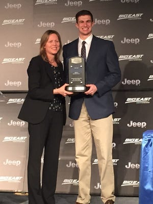 Big East scholar-athlete winner Kellen Dunham, right, of Butler holds trophy with commissioner Val Ackerman.