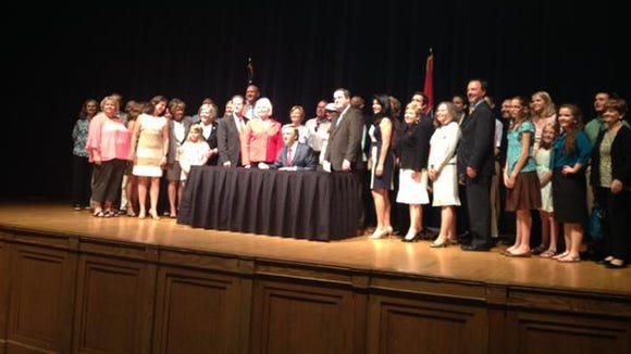 A troop of advocates and lawmakers joined Gov. Bill Haslam on Wednesday for a ceremonial signing of new abortion regulations.