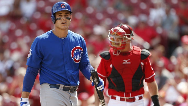 Chicago Cubs first baseman Anthony Rizzo (44) reacts to striking out to Cincinnati Reds relief pitcher J.J. Hoover (60) during the twelfth inning.