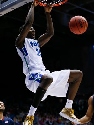 Florida Gulf Coast Eagles forward Demetris Morant (21) dunks during the first half against the Fairleigh Dickinson Knights of First Four of the NCAA men's college basketball tournament at Dayton Arena.