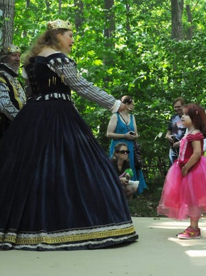 Ina Morreau of Green Bay is proclaimed a future lady in waiting by the queen (Lynne Melssen of Ames, Iowa) during a ceremony at last year's Door County Renaissance Faire.