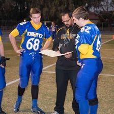 Tempe Prep players (from left) Andrew Stough, Connor Woltz and Christian Gaylor listen to coach Tommy Brittain during a game in 2013.