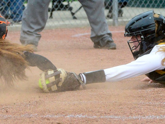 Gibsonburg's Keely Snyder slides past the tag of Old Fort's Whitney Bilger.