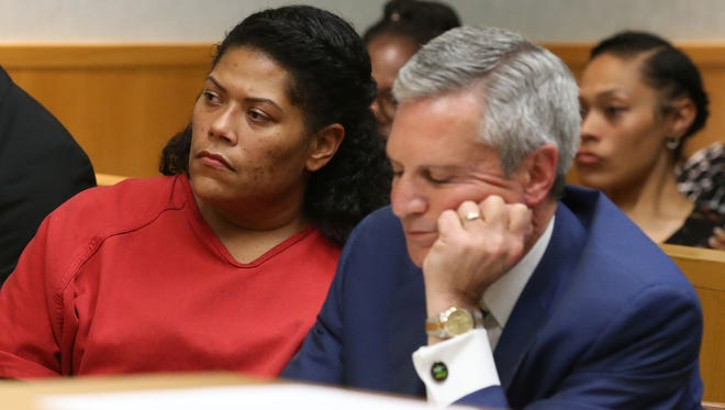 Rochester City Court Judge Leticia Astacio, left, with her attorney, Edward Fiandach, listen as Judge Stephen Aronson finds her guilty of breaking the conditions of her DWI sentence during her hearing at the Hall of Justice in Rochester Thursday, June 8, 2017.