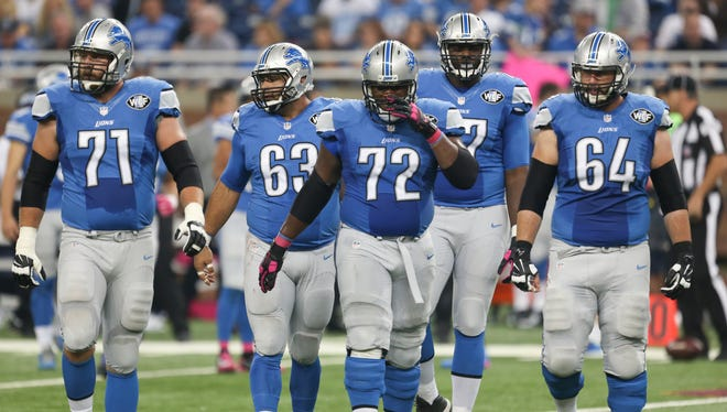 The Detroit Lions offensive line takes the field against the Arizona Cardinals on Oct. 11, 2015, at Ford Field in Detroit.