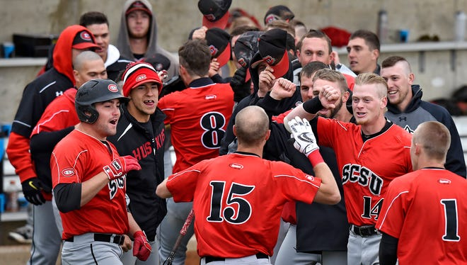 St. Cloud State players congratulate Kyle Lieser (15) on his two-run home run in the bottom of the fifth inning during Friday's game against Augustana at Dick Putz Field in St. Cloud.