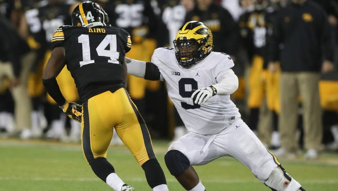 Michigan's Mike McCray is called for a face mask on Iowa's Desmond King during the second half of U-M's 14-13 loss Saturday in Iowa City, Iowa.