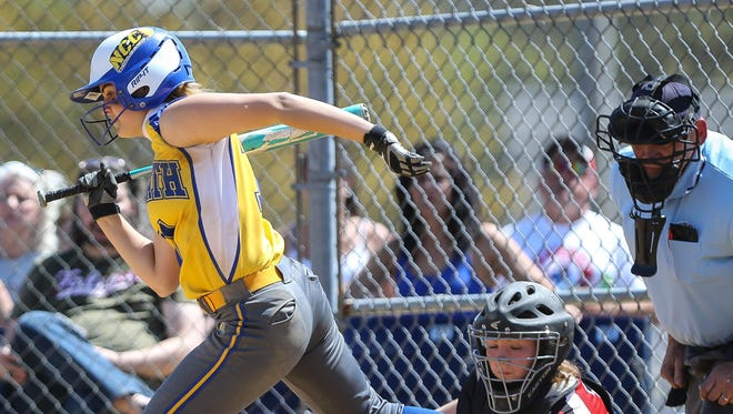 NewCath's Lexy Breen does some fancy footwork to avoid a wild pitch Saturday.