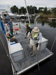 An Escambia County environmental team works on mapping