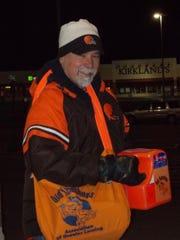 Old Newsboys volunteer Jeff Rudnick hawks The Lansing