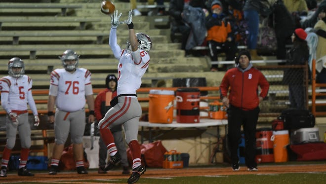Bellevue's Bryce McMurray catches a touchdown pass Friday.