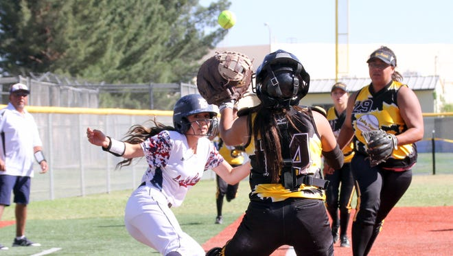 Junior Valerie Lopez was caught in a run-down between third base and home plate on Tuesday against Alamogordo. She beat the run-down and scored to help Deming to a 10-6 victory in game one.